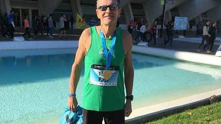 Paul Mingay, pictured after his UK over-60 veteran record-breaking run at the Valencia Marathon, in