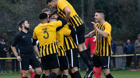 Stowmarket Town players celebrate during their 2-1 win over Mildenhall Town, in their last league ou