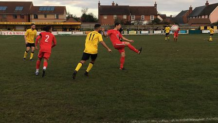 Stowmarket's Luke Reed nudges the ball forward during this afternoon's Thurlow Nunn Premier clash at