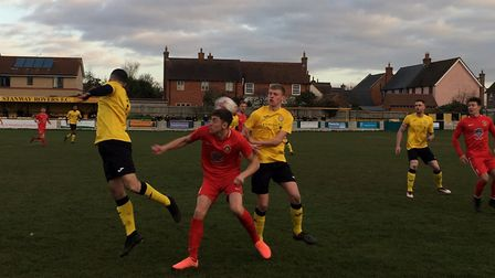 Josh Mayhew (red) stoops to head the ball during the first half of today's league match at The Hawth
