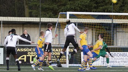 Chukwula Ubah (no 6) heads the opening goal for Cambridge City in their win over AFC Sudbury. Pictur