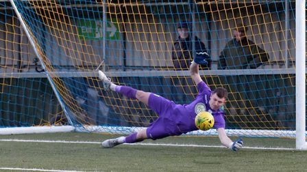 Cambridge City stopper Daniel George saves Tom Maycock's penalty for AFC Sudbury. Picture: PAUL VOLL