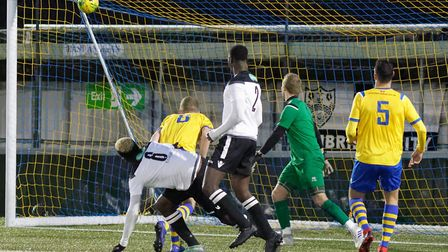 Chukwula Ubah (no 6, white shirt) watches his header enter the net for his and Cambridge's second go