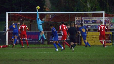 Seasiders' keeper Danny Crump tips over a goal-bound cross during the home defeat to Romford. Pictur