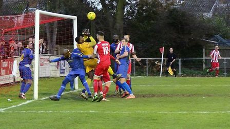 A goalmouth scramble leading up to Felixstowe & Walton United's equaliser, against Romford. Picture: