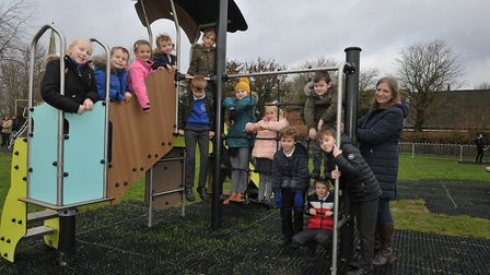 Acting Head of Woolpit Primary school Pippa Holmes with the children enjoying their new playground