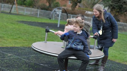 Children from Woolpit Primary school enjoying their new play equipment Picture: SARAH LUCY BROWN