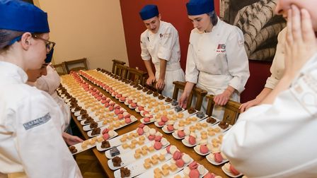 The sudents worked under the guidance of top local chefs to prepare the meals Picture: BRIAN TUNBRI