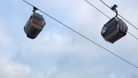 The gondola cable cars make tjheir way across the start-finish area of the Victoria Dock parkrun. Pi