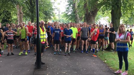 Mind the lampost. Runners congregate for the start of the King's Lynn parkrun, at The Walks in Norfo