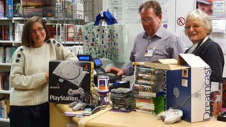 Michelle Chambers, left, Stephen Thorne and Pat Cassidy with retro video games and consoles at the E