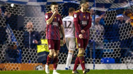 Gwion Edwards and Cole Skuse pictured after Town had conceded at Portsmouth. Picture: Steve Walle