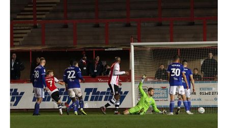 Lee Martin scores the winner for Exeter City in the EFL Trophy Photo: ROSS HALLS
