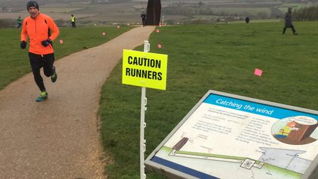 Catching the wind: the sign says it all as a runner approaches the finish to the Dunstable Downs par