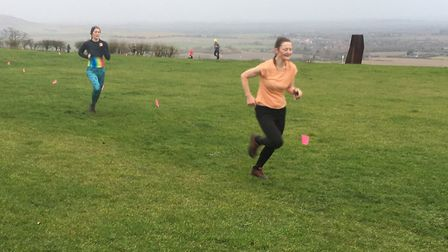 Runners on the homeward stretch on top of Dunstable Downs during last Saturday's windswept parkrun.