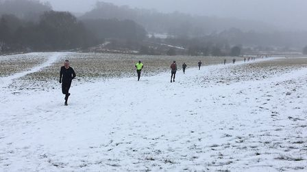 The snowy scene during the 'sprint' to the finish at the Panshanger parkrun. Picture: CARL MARSTON