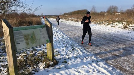Runners make their way along the icy route at Ellenbrook Fields parkrun, which survived the cold sna