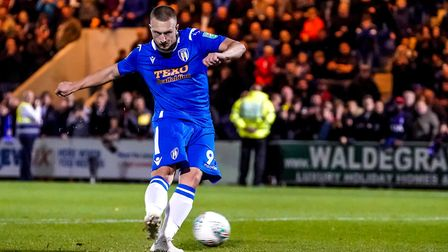 Spot on: Luke Norris, firing home his penalty in the U's 4-3 shoot-out victory over Tottenham, will