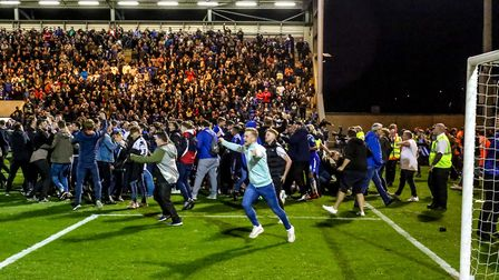 Fans flood onto the pitch after Colchester United's penalty shoot-out victory over Tottenham. U's su