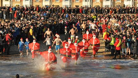 The Lowestoft Christmas Day Swim as captured from Lowestoft Lifeboat. Picture: RNLI/Nigel Lyman.