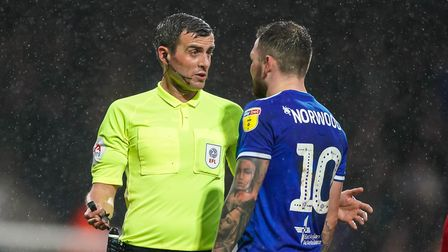 Referee Craig Hicks in discussion with James Norwood.,Picture: Steve Waller www.stephenwalle