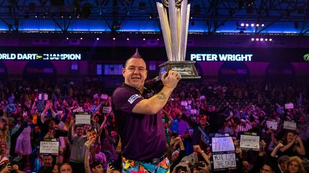 Peter Wright celebrates with the Sid Waddell trophy during day sixteen of the William Hill World Cha