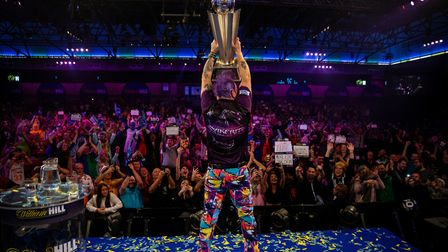 Peter Wright celebrates with the Sid Waddell trophy after his victory at the William Hill World Cham