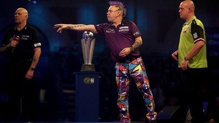 Peter Wright takes to the oche during the final of the William Hill World Championships at Alexandra