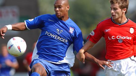Marcus Bent, left, in action for Ipswich Town against Crewe's Stephen Foster, in 2003. Picture: TOMM