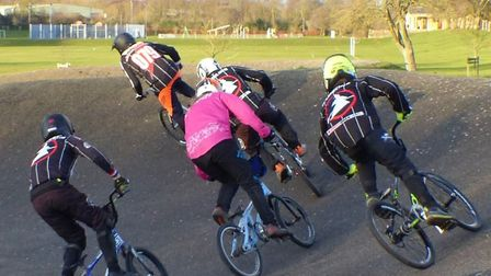 Tom Webb (Ipswich BMX, 079) leads a posse of clubmates round the final berm of the Christmas fun rac