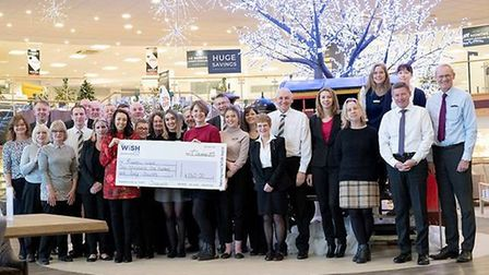 Glasswells staff hand over the proceeds from the quiz night to West Suffolk Hospital Picture: GLASS
