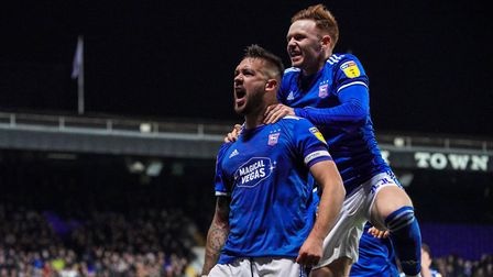 Luke Chambers (left) has missed eight of Ipswich Town's last 10 games with a neck/back problem. Phot