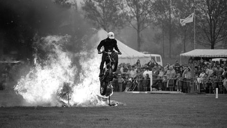 A motor bike stunt man leaps through a raging fire at the Hadleigh Show Picture DAVID KINDRED