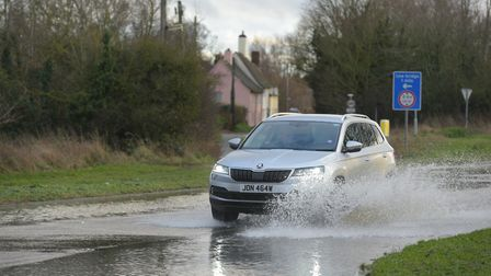 Vehicles pass through the flood water on the B113 near Bramford Picture: SARAH LUCY BROWN