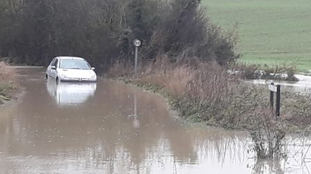 Peugeot caught in the flood water on Lower Road in Lavenham Picture: KARL GRIMWADE