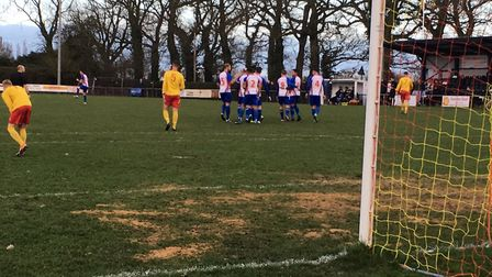 FC Clacton players (blue shirts) celebrate taking an early lead at Walsham-le-Willows. Picture: CARL