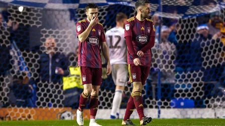 Gwion Edwards and Cole Skuse pictured after Town had conceded at Portsmouth.Picture: Steve Walle