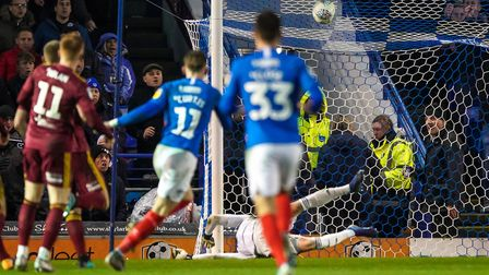Ronan Curtis (11) scores the only goal of the game as Portsmouth the the lead.Picture: Steve Wall