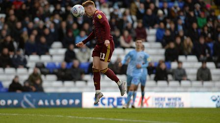 Jon Nolan is off-target with a free header against Coventry. Photo: Pagepix