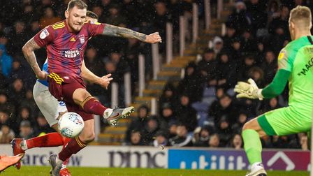 James Norwood fires wide from close-range against Portsmouth. Photo: Steve Waller