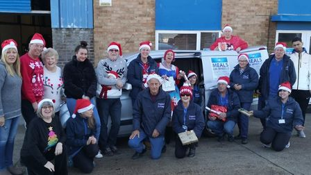 Amazing staff members from Aspect Living Meals on Wheels out delivering hot meals, presents and crac