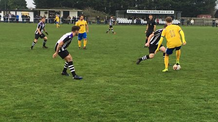 Newmarket Town's Jack Chandler (No.11), on the ball against Long Melford. Chandler scored the openin