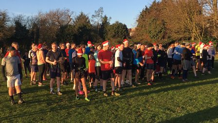 Runners and walkers, many of them with Christmas hats, congregate before the start of the Roding Val