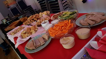 Angela with some of the volunteers and the New Year's Day spread Picture: RACHEL EDGE
