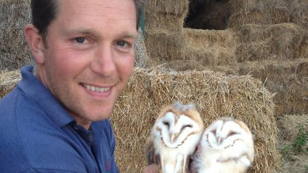 Patrick holding two barn owl chicks Picture: SUFFOLK COMMUNITY BARN OWL PROJECT