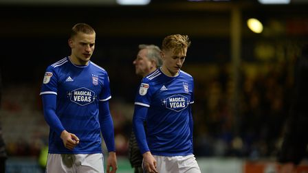 Luke Woolfenden and Flynn Downes leave the pitch after the defeat at Lincoln City Picture Pagepix