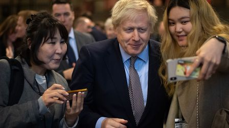 Prime Minister Boris Johnson poses for photographs after the election - but he now has his own chall