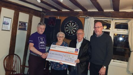 Earl Stonham Bowls Club chairwoman Dorothy Pryke and president Tony Stiff, middle and middle right,