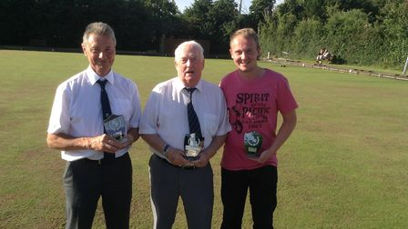Former Earl Stonham Bowls Club captain Fred Mitson with two other members of the club after winning
