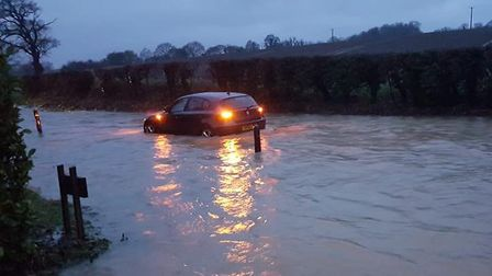 The B1078 in Hemingstone, close to Ipswich, is submerged this morning Picture: KAREN BYRNAND